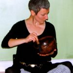 ANXIETY WORKSHOP AT YOGA WELL 03.19.11 playing the singing bowl1 CROP